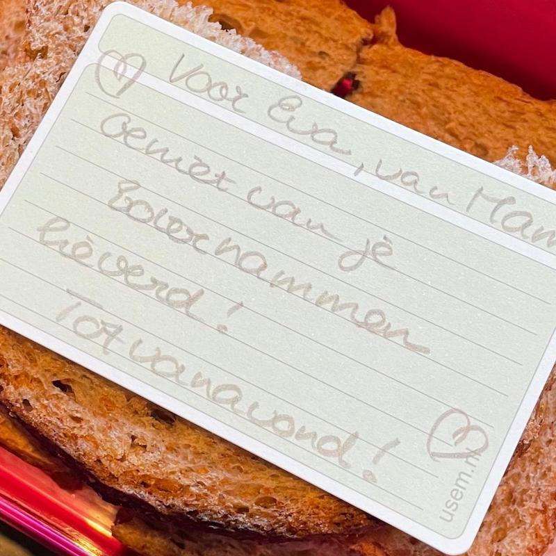 Handwritten note in a lunch box