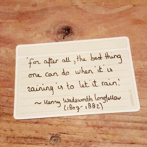 Handwritten Henry Wadsworth Longfellow quote on a usem note card - let it rain