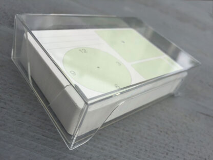 Green appointment cards in transparent card box
